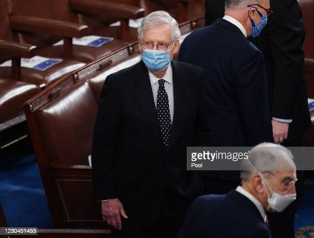Senate Majority Leader Mitch McConnell arrives for the Electoral College vote certification for President-elect Joe Biden, during a joint session of...