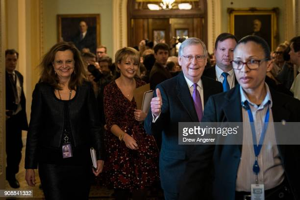 Senate Majority Leader Mitch McConnell gives the thumbs up after the Senate passed a procedural vote for a continuing resolution to fund the federal...
