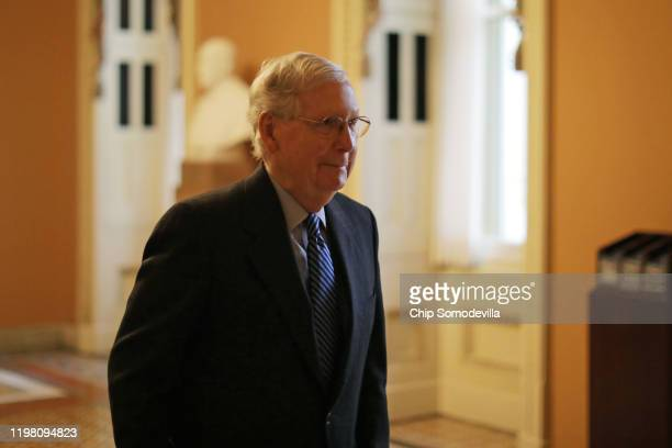Senate Majority Leader Mitch McConnell heads to the Senate chamber ahead of the weekly Senate Republicans policy luncheon at the US Capitol January...