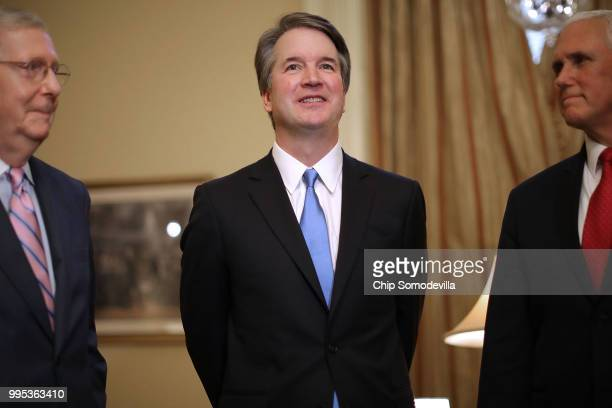 Senate Majority Leader Mitch McConnell , Judge Brett Kavanaugh and Vice President Mike Pence pose for photographs before a meeting in McConnell's...