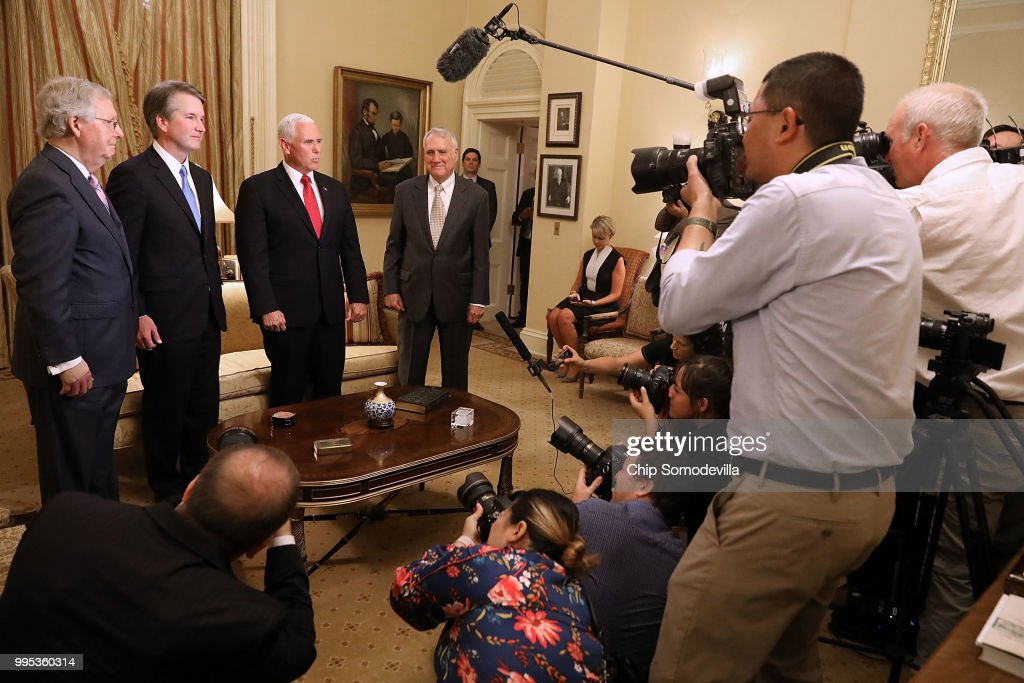 Senate Majority Leader Mitch McConnell (R-KY), Judge Brett Kavanaugh, Vice President Mike Pence and former Sen. Jon Kyl (R-AZ) pose for photographs before a meeting in McConnell's office in the U.S. Capitol July 10, 2018 in Washington, DC. U.S. President Donald Trump nominated Kavanaugh to succeed retiring Supreme Court Associate Justice Anthony Kennedy.