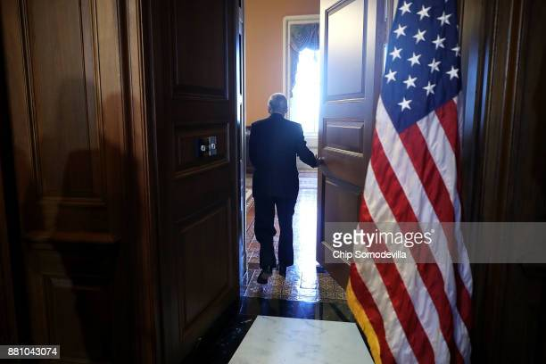 Senate Majority Leader Mitch McConnell leaves a rally for tax reform legislation with fellow Senate GOP leaders and representatives from small...