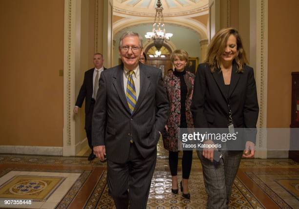 Senate Majority Leader Mitch McConnell leaves from the senate floor on capitol hill on January 20 2018 in Washington DC Republicans and Democrats...