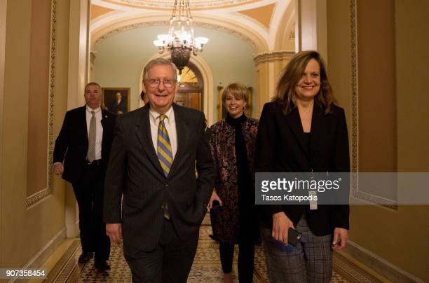 Senate Majority Leader Mitch McConnell leaves from the senate floor on capital hill on January 20 2018 in Washington DC Republicans and Democrats...