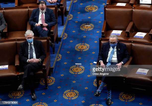 Senate Majority Leader Mitch McConnell looks on with U.S. Senate Minority Leader Chuck Schumer (in the House Chamber during a reconvening of a joint...