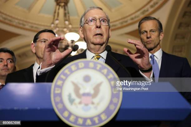 Senate Majority Leader Mitch McConnell of Ky accompanied by from left Sen Cory Gardner RColo Sen John Barrasso RWyo and Sen John Thune RSD speaks to...