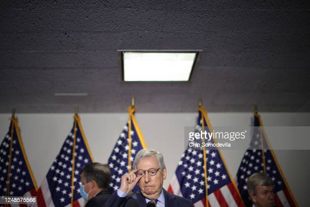 Senate Majority Leader Mitch McConnell prepares to talk with reporters following the weekly Senate Republican policy luncheon in the Hart Senate...