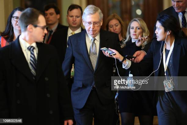 Senate Majority Leader Mitch McConnell R_KY is trailed by reporters after speaking on the floor of the US Senate on January 22 2019 in Washington DC...