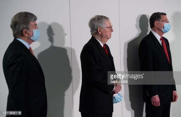 Senate Majority Leader Mitch McConnell, Republican of Kentucky, stands alongside Senator Roy Blunt , Republican of Missouri, and Senator John...