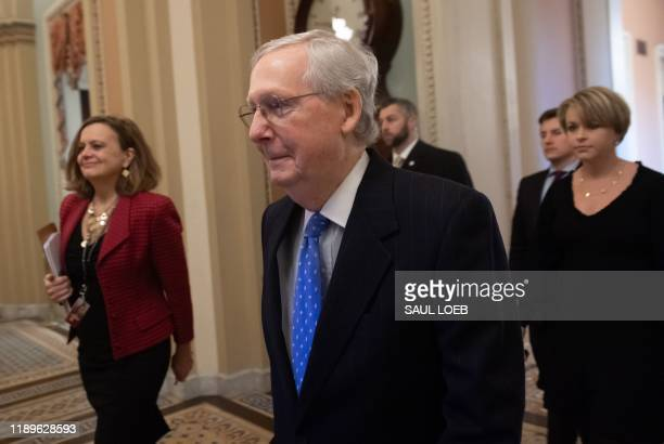 Senate Majority Leader Mitch McConnell Republican of Kentucky walks through the US Capitol in Washington DC December 19 2019 Senate Majority Leader...