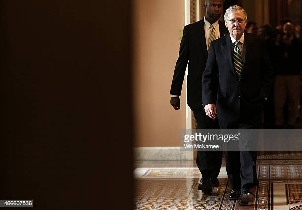 Senate Majority Leader Mitch McConnell returns to his office following a press conference at the US Capitol March 17 2015 in Washington DC McConnell...