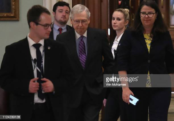 Senate Majority Leader Mitch McConnell returns to his office after the US Senate adjourned for the day January 23 2019 in Washington DC McConnell has...