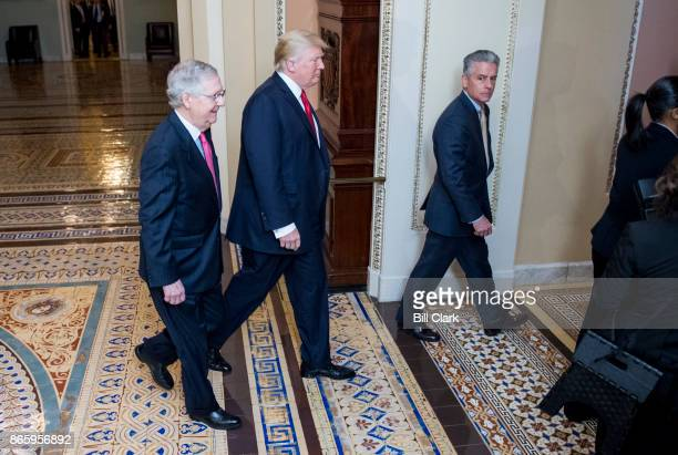 Senate Majority Leader Mitch McConnell RKy and President Donald Trump arrive for the Senate Republicans' policy lunch in the Capitol on Tuesday Oct...