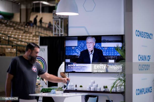 Senate Majority Leader Mitch McConnell RKy appears in a video displayed at the GenCanna booth at the Southern Hemp Expo at the Williamson County...