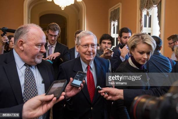 Senate Majority Leader Mitch McConnell RKy walks to the Senate floor after saying to the media that Republicans have enough votes to pass the tax...