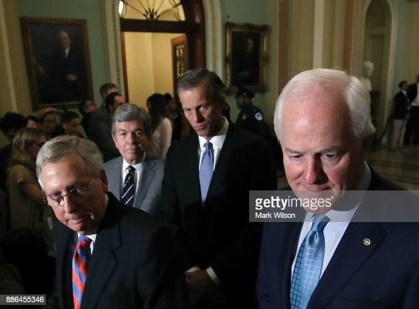 Senate Majority Leader Mitch McConnell Sen Roy Blunt Sen John Thune and Sen John Cornyn listen to reporters questions about the tax reform bill the...
