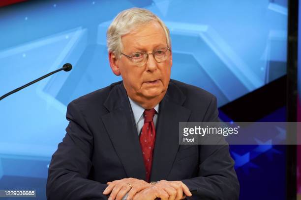 Senate Majority Leader Mitch McConnell speaks during a debate with Democratic challenger Amy McGrath on October 12, 2020 in Lexington, Kentucky. The...