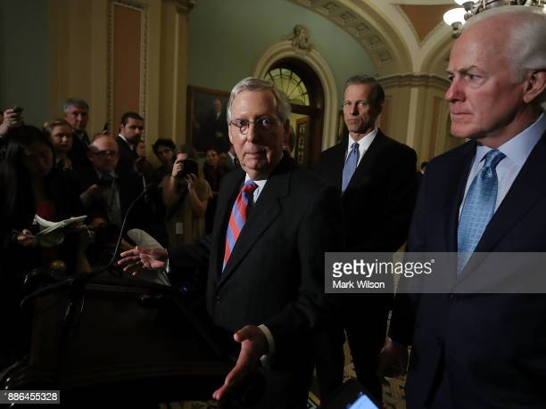 Senate Majority Leader Mitch McConnell speaks to reporters about the tax reform bill the Senate passed last week at US Capitol on December 5 2017 in...