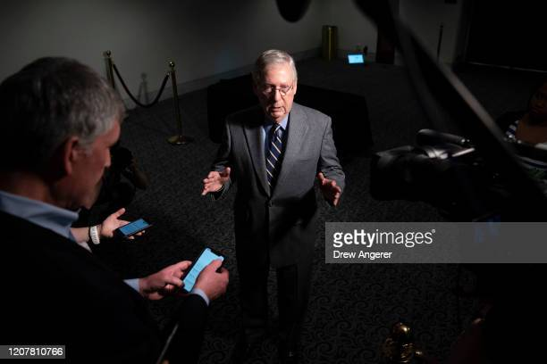 Senate Majority Leader Mitch McConnell speaks to reporters after exiting a meeting with a select group of Senate Republicans Senate Democrats and...