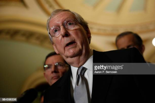 Senate Majority Leader Mitch McConnell speaks with reporters following the weekly policy luncheons at the US Capitol June 26 2018 in Washington DC...