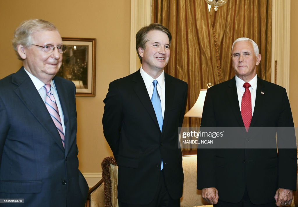 US Senate Majority Leader Mitch McConnell, Supreme Court associate justice nominee Brett Kavanaugh and US Vice President Mike Pence pose in McConnell's office in the US Capitol in Washington, DC on July 10, 2018.