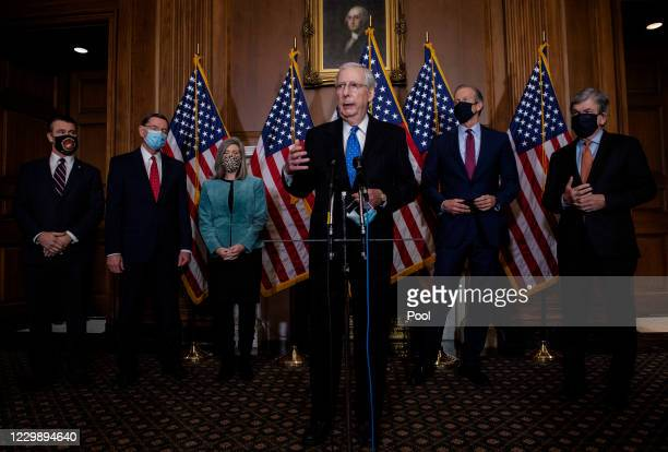 Senate Majority Leader Mitch McConnell talks to reporters following the weekly Republican Senate conference meeting in the Mansfield Room at the U.S....