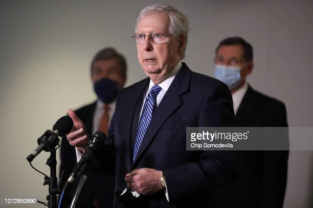 Senate Majority Leader Mitch McConnell talks to reporters following the weekly Republican policy luncheon in the Hart Senate Office Building on...