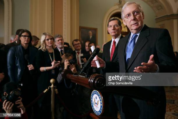 Senate Majority Leader Mitch McConnell talks to reporters with Sen John Barrasso following the weekly Senate Republican policy luncheon in the US...