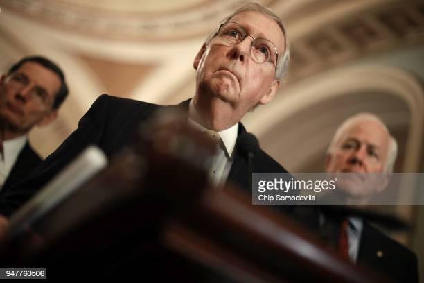 Senate Majority Leader Mitch McConnell talks to reporters with Sen John Barrasso and Senate Majority Whip John Cornyn following the Senate Republican...