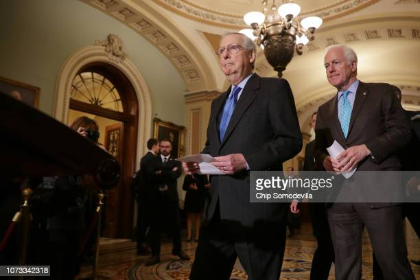 Senate Majority Leader Mitch McConnell talks to reporters with Senate Majority Whip John Cornyn following the weekly Senate Republican policy...