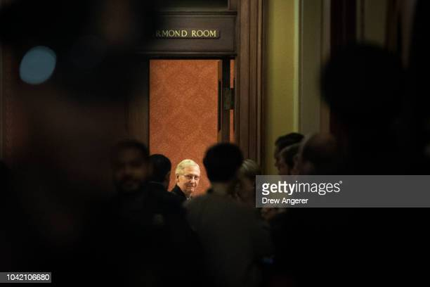 Senate Majority Leader Mitch McConnell waits for fellow GOP Senators to arrive at the start of a closeddoor GOP caucus meeting following the Senate...