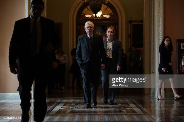S Senate Majority Leader Mitch mcConnell walks back to his office after a weekly Senate Republican policy luncheon September 25 2018 at the Capitol...