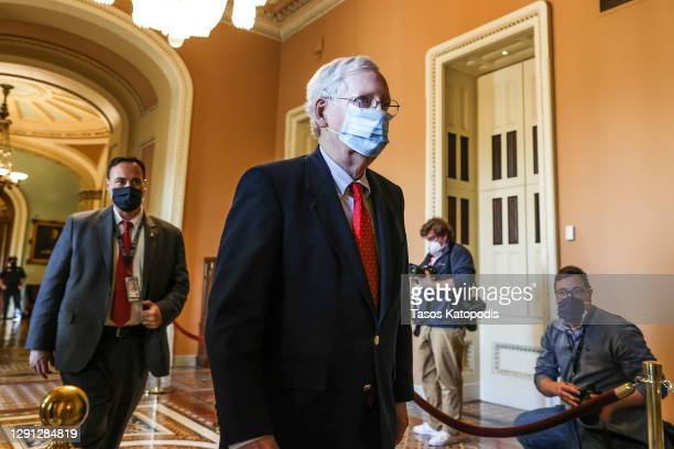 Senate Majority Leader Mitch McConnell walks back to his office after opening up the Senate on Capitol Hill on December 14, 2020 in Washington, DC....