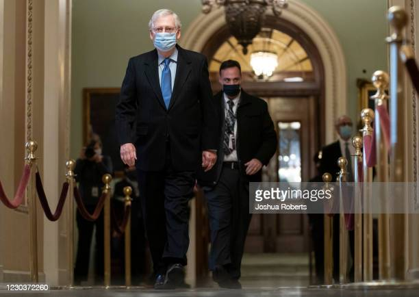 Senate Majority Leader Mitch McConnell walks from from the Senate Chamber as the Senate resumes debate on overriding the veto of the National Defense...