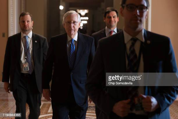 Senate Majority Leader Mitch McConnell walks from his office to the Senate chamber at the US Captiol December 19 2019 in Washington DC The Senate...