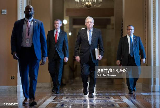 S Senate Majority Leader Mitch McConnell walks from his office to the Senate floor at the US Capitol on March 18 2020 in Washington DC McConnell is...