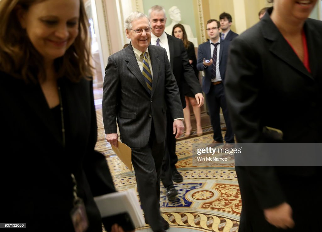 Senate Majority Leader Mitch McConnell walks from his office to the floor of the U.S. Senate to make a brief speech on the looming government shutdown January 19, 2018 in Washington, DC. Congress continues to wrestle with passage of a continuing resolution to fund the federal government past midnight this evening.