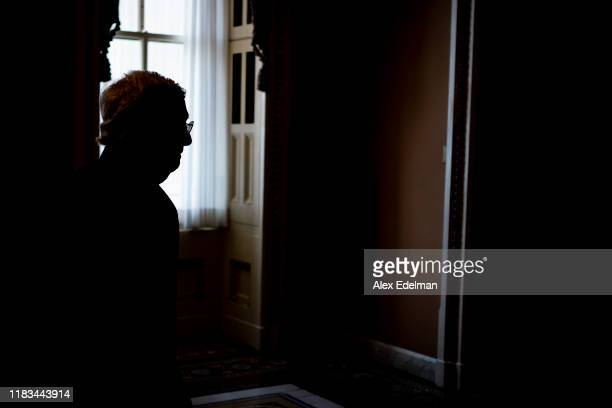 Senate Majority Leader Mitch McConnell walks members of his staff outside his office in the US Capitol on November 19 2019 in Washington DC MCConnell...