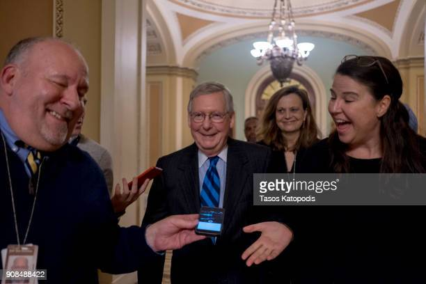 S Senate Majority Leader Mitch McConnell walks out of the senate on Capitol Hill on January 21 2018 in Washington DC The US government is shut down...