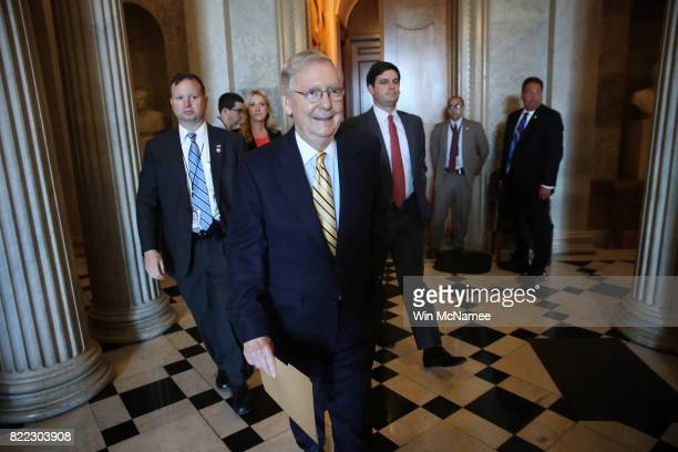 Senate Majority Leader Mitch McConnell walks to a meeting in the US Capitol July 25 2017 in Washington DC The US Senate is scheduled to hold a key...