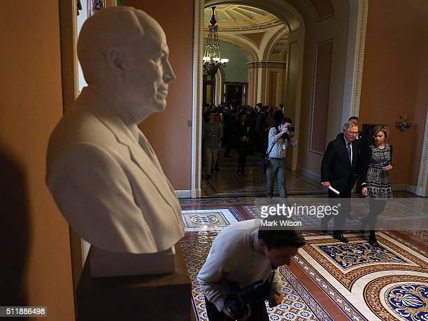 Senate Majority Leader Mitch McConnell walks to his office after speaking to the media about the recent vacancy at the US Supreme Court on Capitol...