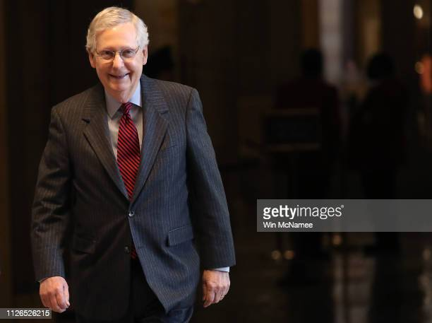 Senate Majority Leader Mitch McConnell walks to the Senate floor for a vote on legislation advancing McConnell's plan voicing opposition to U.S....