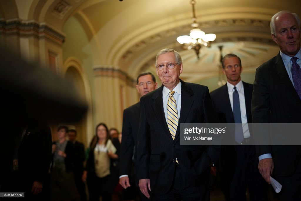 U.S. Senate Majority Leader Mitch McConnell (R-KY) walks with members of the Senate Republican leadership before answering questions at the U.S. Capitol on September 12, 2017 in Washington, DC. McConnell answered a range of questions relating to the upcoming Senate agenda during the press conference. Also pictured are (L-R) Sens. John Barrasso (R-WY), John Thune (R-SD) (2nd R) and John Cornyn (R) (R-TX).