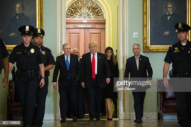 Senate Majority Leader Mitch McConnell walks with Presidentelect Donald Trump and his wife Melania Trump to his office before a meeting at the US...