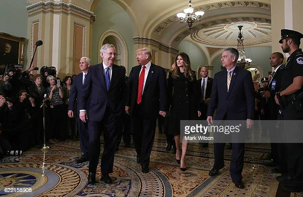 Senate Majority Leader Mitch McConnell walks with Presidentelect Donald Trump his wife Melania Trump and Vice Presidentelect Mike Pence at the US...