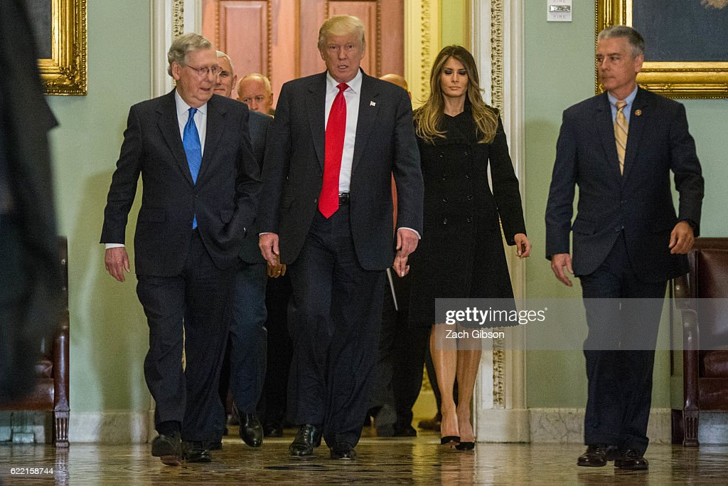 Senate Majority Leader Mitch McConnell (R-KY) walks with President-elect Donald Trump to his office before a meeting at The Capitol Building on November 10, 2016 in Washington, D.C. United States.