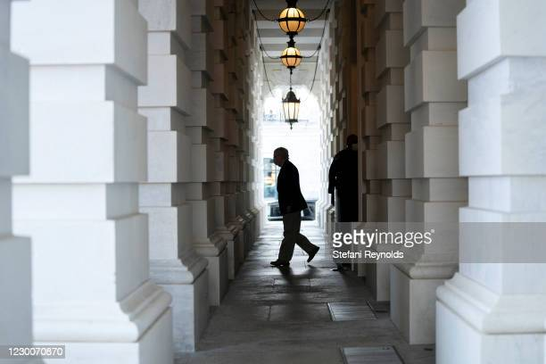 Senate Majority Leader Mitch McConnell wears a protective mask while departing the U.S. Capitol on December 11, 2020 in Washington, DC. The Senate...