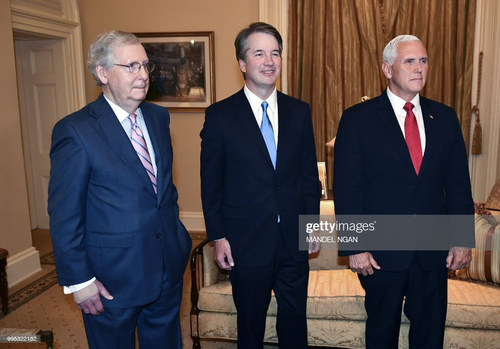 US Senate Majority Leader Mitch McConnell,Supreme Court associate justice nominee Brett Kavanaugh and US Vice President Mike Pence pose in McConnell's office in the US Capitol in Washington, DC on July 10, 2018.