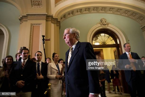 Senate Majority Leader Mitch McConnnell emerges from the Senate Chamber following a procedural vote to open debate on the GOP heath care plan on...