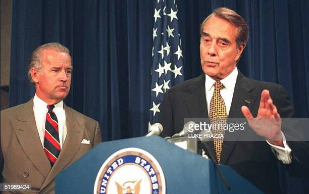 Senate Majority Leader Robert Dole speaks to reporters about the Senate vote to lift the arms embargo over Bosnia at a press conference on Capitol...